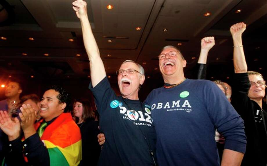 Rick Sturgiol, right, and his partner of 34 years Jim Malatak cheer at an election watch party for proponents of Referendum 74, which would uphold the state's new same-sex marriage law, Tuesday, Nov. 6, 2012, in Seattle. Photo: Elaine Thompson