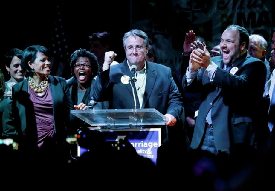 Sen. Richard Madaleno, D-Montgomery, center, celebrates onstage at an Election Night party in Baltimore, Tuesday, Nov. 6, 2012, after voters passed a referendum approving same sex marriage in Maryland. Standing with Madaleno are Baltimore Mayor Stephanie Rawlings-Blake, from left, Rep. Mary Washington, D-Baltimore City, and Rep. Luke Clippinger, D-Baltimore City. Photo: Patrick Semansky