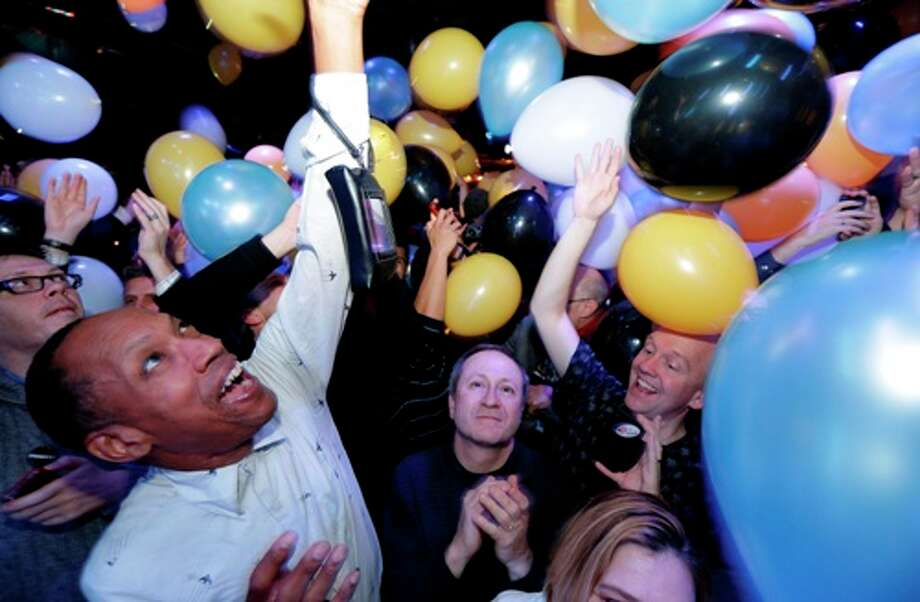 Partygoers react as balloons fall at an Election Night party in Baltimore, Tuesday, Nov. 6, 2012, after voters passed a referendum approving same sex marriage in Maryland. Photo: Patrick Semansky