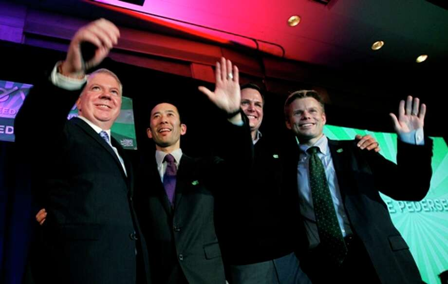Sen. Ed Murray, left, waves with his partner Michael Shiosaki as Rep. Jaime Pedersen, right, stands with his partner Eric Cochran Pedersen at an election watch party for proponents of Referendum 74, which would uphold the state's new same-sex marriage law, Tuesday, Nov. 6, 2012, in Seattle. Photo: Elaine Thompson