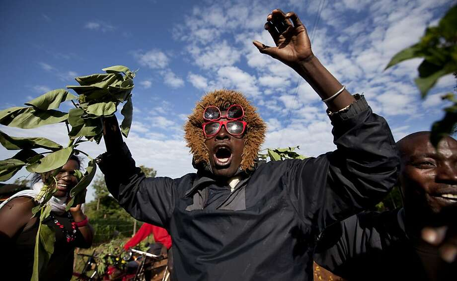 Villagers cheer and wave branches to celebrate Obama's re-election in the village of Kogelo, home to Sarah Obama, the step-grandmother of President Barack Obama, in western Kenya Wednesday, Nov. 7, 2012. Photo: Ben Curtis, Associated Press