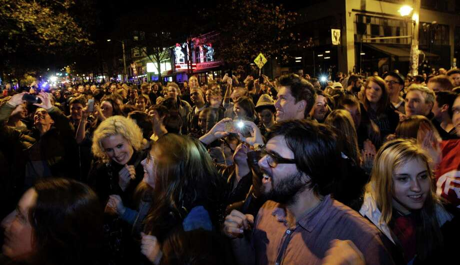 A large crowd of people celebrates at the conclusion of the presidential election in Seattle's Capitol Hill neighborhood, Tuesday, Nov. 6, 2012. The re-election of President Barack Obama and Washington state's referendum 74, which would legalize gay marriage, drew the most supporters to the streets. Photo: TED S. WARREN / ASSOCIATED PRESS