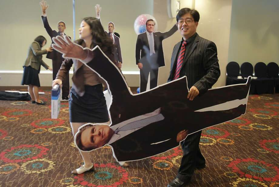 A South Korean man carries a picture of former Massachusetts Gov. Mitt Romney after the U.S. Predential election watch event on November 7, 2012 in Seoul, South Korea. South Koreans and Americans have been paying close attention to the U.S. presidential race between U.S. President Barack Obama and Republican presidential candidate, former Massachusetts Gov. Mitt Romney. According to network projections incumbent U.S. President Barack Obama has won a second term. Photo: Chung Sung-Jun, Getty Images
