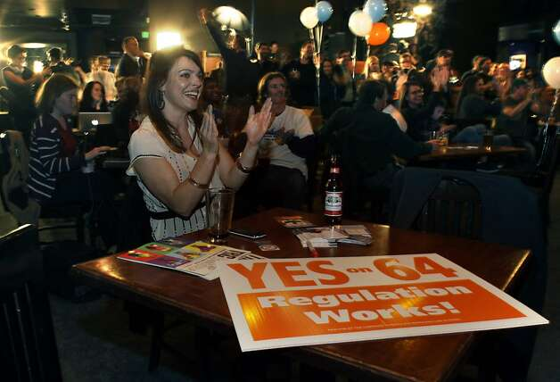 Colorado voters passed Amendment 64 on Nov. 6, legalizing marijuana for recreational use. Here Amanda Jetter joins cheering patrons in a Denver bar as the results are announced. Photo: Brennan Linsley, Associated Press