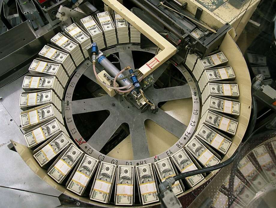 Stacks of $10,000 worth of newly redesigned $100 bills are sorted at the Bureau of Engraving and Printing in Washington, Thursday, March 21, 1996. The new bills will be shipped to banks nationwide starting Monday, March 25, 1996. (AP Photo/Doug Mills) Photo: Doug Mills, Associated Press