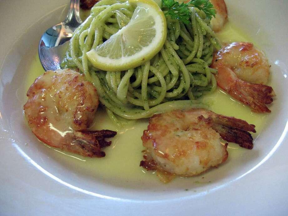 The Shrimp Alejandra is served with basil pesto spaghetti pasta and lemon butter garlic sauce. Photo: Jennifer McInnis, San Antonio Express-News