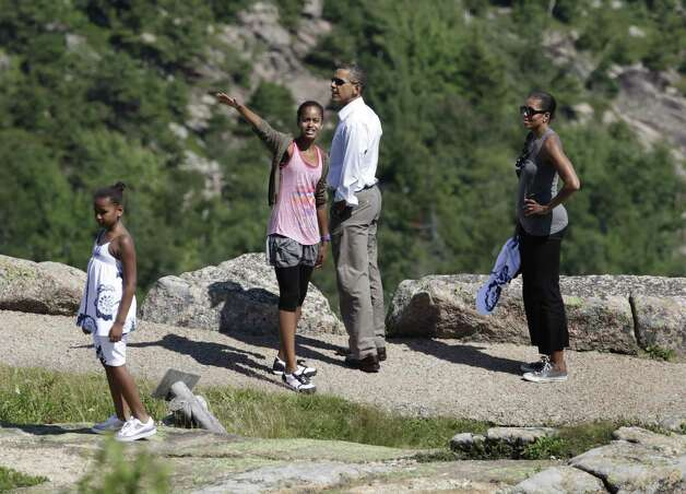 Sasha, Malia, Barack and Michelle Obama hike a trail on Cadillac Mountain during the first family's weekend vacation in Bar Harbor, Maine, on July 16, 2010. Photo: YURI GRIPAS, AFP/Getty Images / 2010 AFP