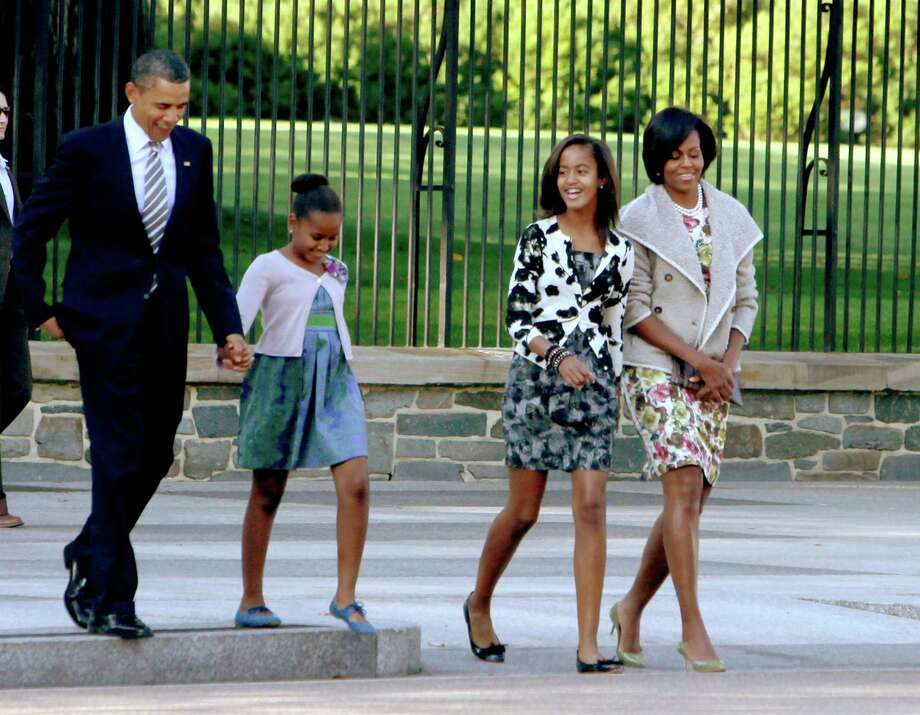 Barack, Sasha, Malia and Michelle Obama walk across LaFayette Park to St. John's Episcopal Church on Sept. 19, 2010 in Washington, D.C. Photo: Pool, Getty Images / 2010 Getty Images