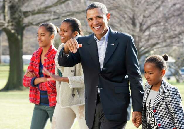 Malia, Michelle, Barack and Sasha Obama walk out of Marine One upon returning at the White House in Washington, D.C., on Jan. 4, 2011, from vacation in Hawaii. Photo: JEWEL SAMAD, AFP/Getty Images / 2011 AFP