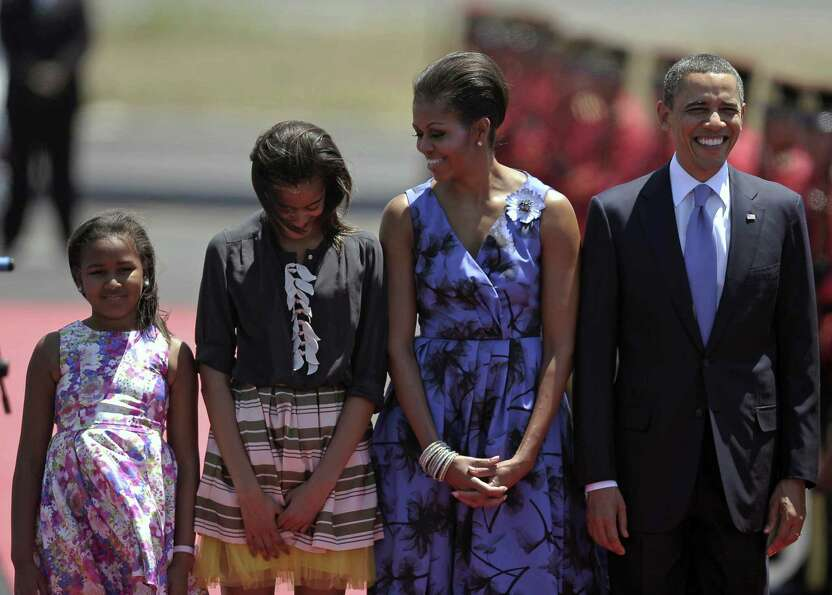 Sasha, Malia, Michelle and Barack Obama are welcomed upon their arrival at the airport in the San Sa