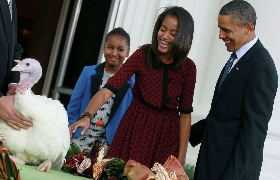 President Barack Obama, with daughters Sasha and Malia, pardons 'Liberty', a 19-week old, 45-pound t