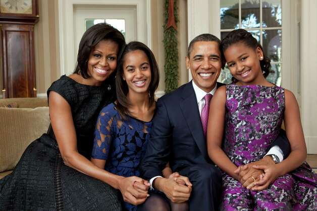 The Obamas sit for a family portrait in the Oval Office on Dec, 11, 2011, in Washington, D.C. Photo: Handout, Getty Images / 2011 The White House