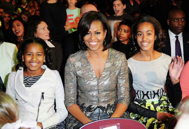 Sasha, Michelle and Malia Obama attend Nickelodeon's 25th Annual Kids' Choice Awards held at Galen Center on March 31, 2012, in Los Angeles. Photo: Kevork Djansezian, Getty Images / 2012 Getty Images