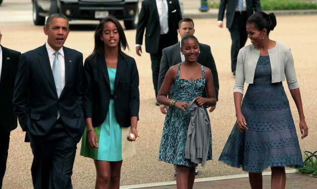 The Obamas walk from the White House to St. John's Episcopal Church Aug. 19, 2012, in Washington, D.C. Photo: Pool, Getty Images / 2012 Getty Images
