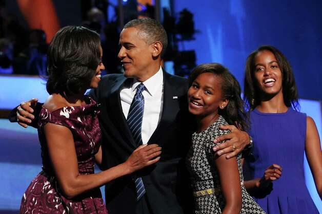 The Obamas gather on stage after Barack Obama accepted his party's presidential nomination during the final day of the Democratic National Convention at Time Warner Cable Arena on Sept. 6, 2012 in Charlotte, N.C. Photo: Chip Somodevilla, Getty Images / 2012 Getty Images