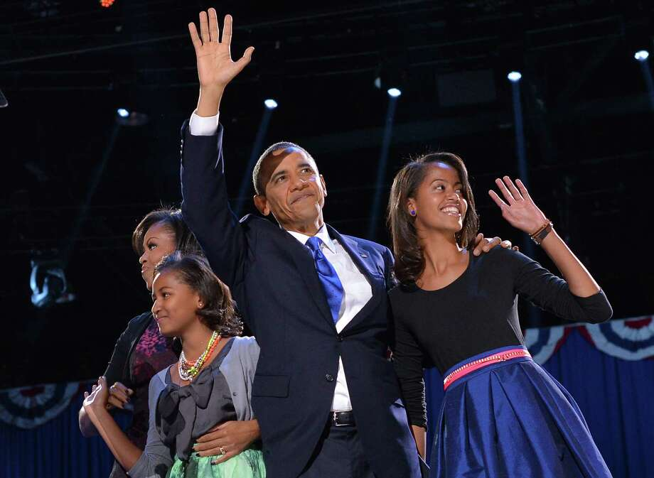 Many people who watched President Barack Obama and his family on election night were struck by how much his daughters -- Malia, 14 (right), and Sasha, 11 -- have grown. We knew Obama's hair had grayed, but when did Malia get almost as tall as her mom (Michelle, left)? Click on to track the family's changes over the past eight years. Photo: JEWEL SAMAD, AFP/Getty Images / 2012 AFP