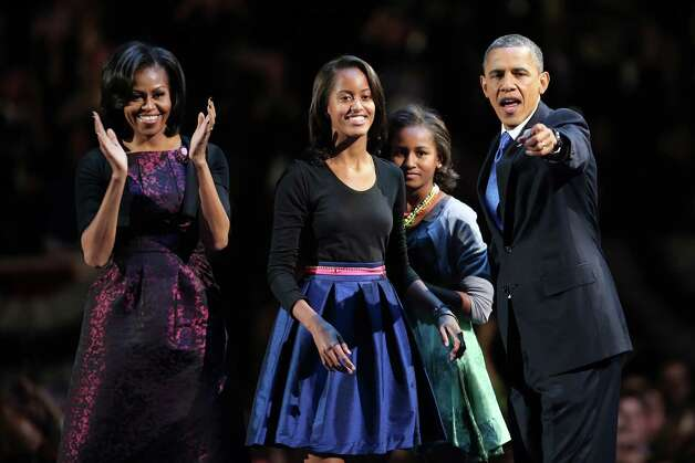 President Barack Obama celebrates his re-election on stage with Michelle, Malia and Sasha in Chicago on Nov. 7, 2012. Photo: Spencer Platt, Getty Images / 2012 Getty Images