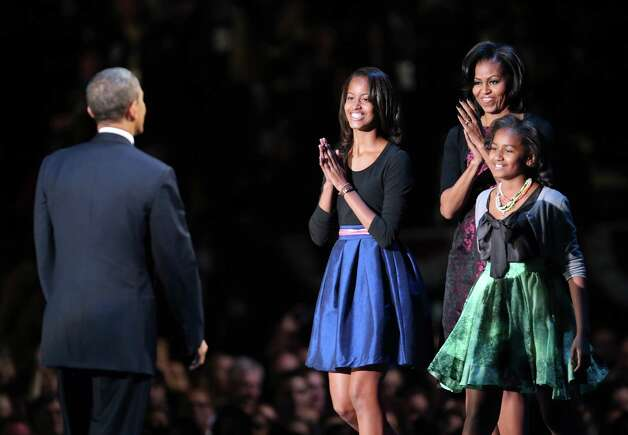 Malia, Michelle and Sasha Obama greet Barack Obama after the president's victory speech on election night at McCormick Place Nov. 6, 2012 in Chicago. Photo: Spencer Platt, Getty Images / 2012 Getty Images