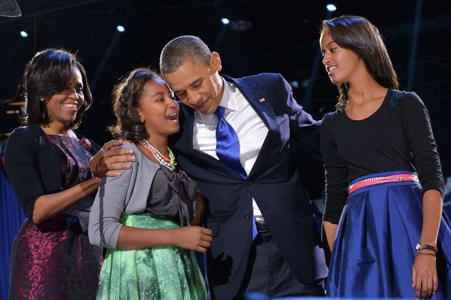 President Barack Obama celebrates his re-election on stage with Michelle, Sasha and Malia in Chicago