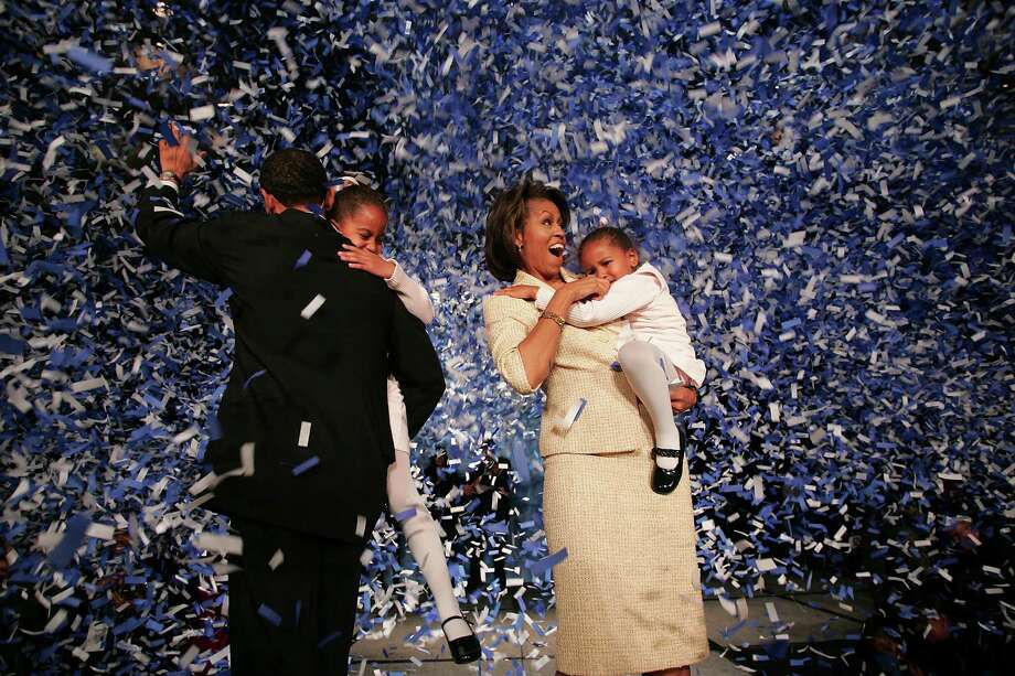 Barack Obama celebrates his Senate victory with Malia, Michelle and Sasha on Nov. 2, 2004 in Chicago. Photo: Scott Olson, Getty Images / 2004 Getty Images
