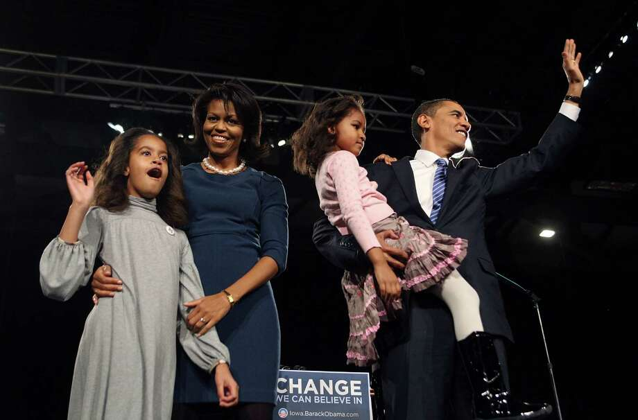 Democratic Presidential hopeful Senator Barack Obama greets supporters with Malia, Michelle and Sasha during a post-caucus celebration at the Hy-Vee Center Jan. 3, 2008 in Des Moines, Iowa. Photo: Scott Olson, Getty Images / 2008 Getty Images