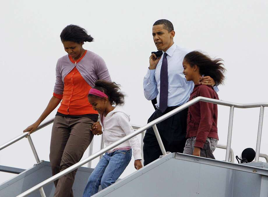 Democratic presidential candidate Barack Obama gets off a plane with Michelle, Sasha and Malia at Indianapolis International Airport on May 3, 2008. Photo: EMMANUEL DUNAND, AFP/Getty Images / 2008 AFP