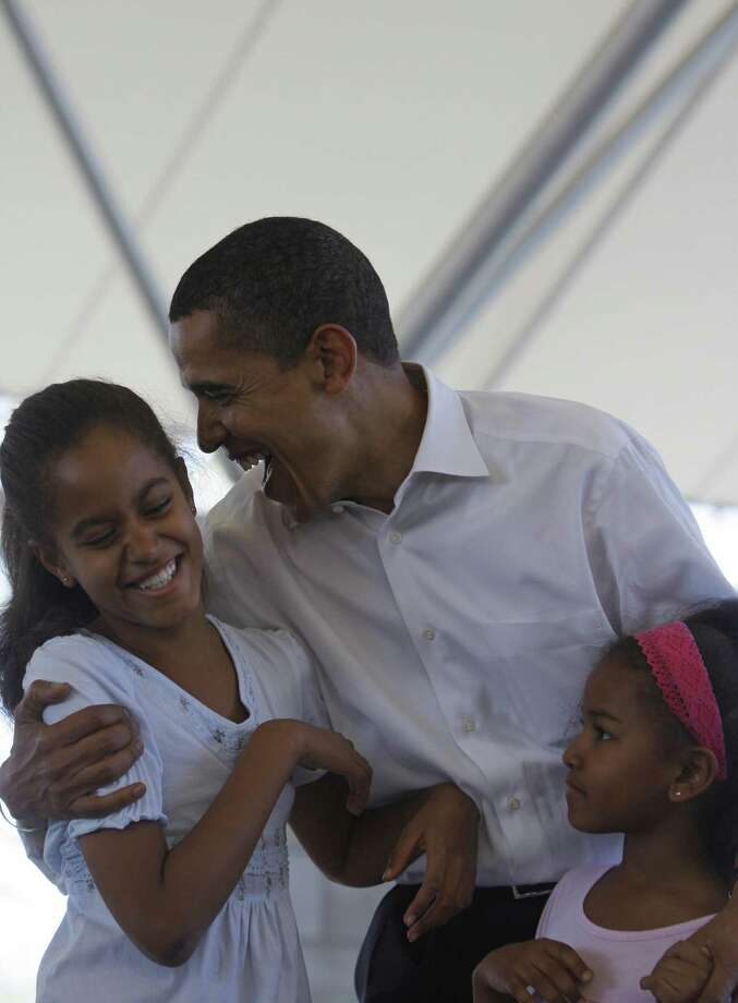 Democratic presidential candidate Barack Obama jokes with Malia and Sasha during a family picnic in Fort Wayne, Indiana, May 4, 2008. Photo: EMMANUEL DUNAND, AFP/Getty Images / 2008 AFP