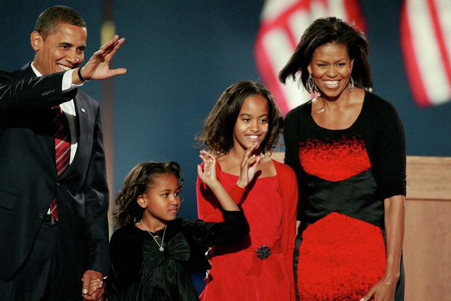 U.S. President-elect Barack Obama walks on stage with his wife, Michelle, and daughters, Sasha and Malia, to address his supports during an election night gathering in Grant Park on Nov. 4, 2008 in Chicago. Photo: Scott Olson, Getty Images / 2008 Getty Images