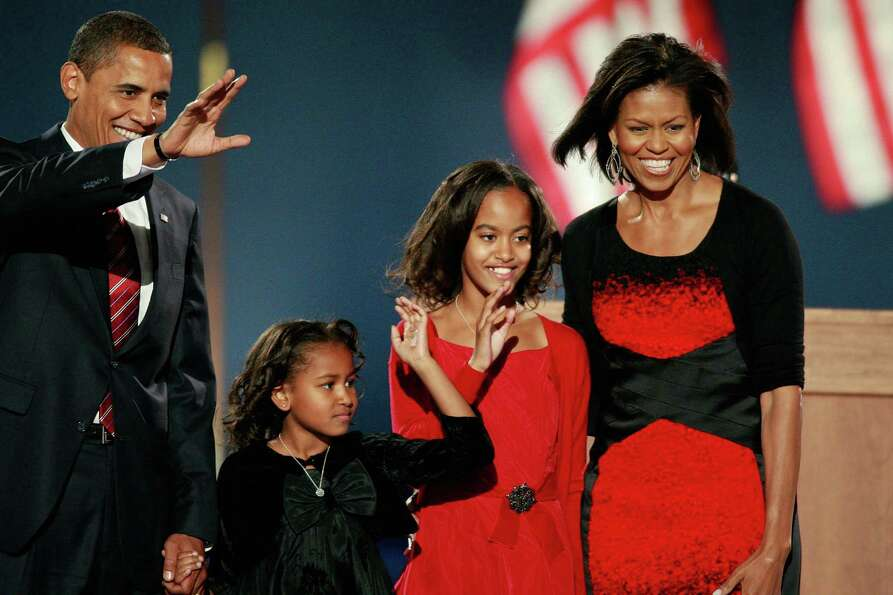 U.S. President-elect Barack Obama walks on stage with his wife, Michelle, and daughters, Sasha and M