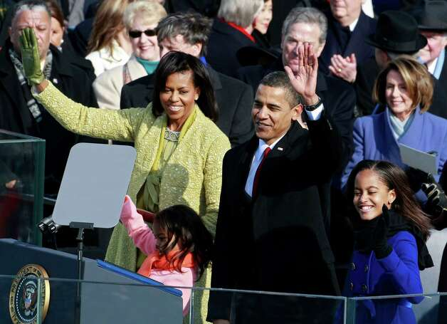 President Barack Obama, his wife, Michelle, and daughters, Sasha and Malia, wave after Obama is sworn in as the 44th president of the United States on Jan. 20, 2009, in Washington, D.C. Photo: Mark Wilson, Getty Images / 2009 Getty Images