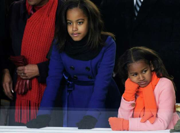 Malia and Sasha Obama watch the Inaugural Parade from the reviewing stand in front of the White House Jan. 20, 2009, in Washington, D.C. Photo: Alex Wong, Getty Images / 2009 Getty Images