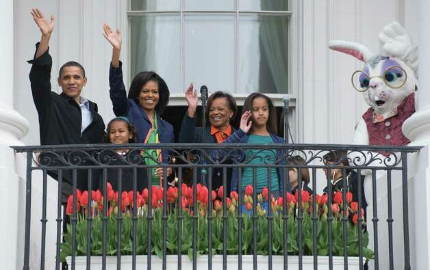 President Barack Obama, his wife, Michelle, daughters, Sasha and Malia, Michelle's mother, Marian Robinson, and the Easter Bunny wave from the Truman Balcony during the annual White House Easter Egg Roll on the South Lawn of the White House in Washington, DC, on April 13, 2009. Photo: AFP/Getty Images