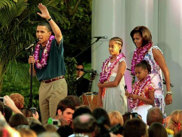 Barack, Michelle, Malia and Sasha Obama host a luau for members of Congress and their families on the South Lawn of the White House June 25, 2009, in Washington, D.C. Photo: Chip Somodevilla, Getty Images / 2009 Getty Images