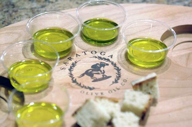 A view of some of the different olive oils ranging from mild to medium to robust at the Saratoga Olive Oil Co. on Tuesday, Oct. 30, 2012 on Broadway in Saratoga Springs, NY.  The store sells different flavors of olive oil, balsamic vinegar and salt. (Paul Buckowski / Times Union) Photo: Paul Buckowski