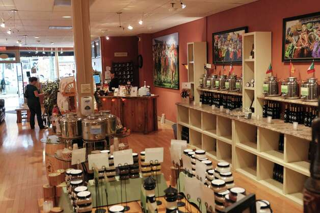 A view from inside the store at the Saratoga Olive Oil Co. on Tuesday, Oct. 30, 2012 on Broadway in Saratoga Springs, NY.  The store sells different flavors of olive oil, balsamic vinegar and salt. (Paul Buckowski / Times Union) Photo: Paul Buckowski