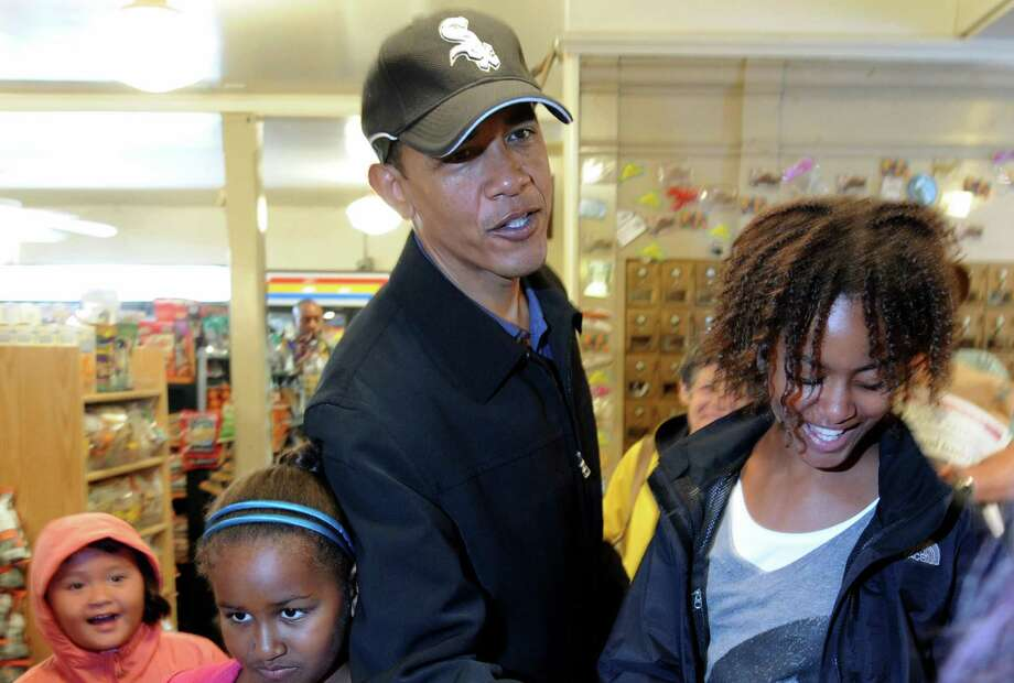 US President Barack Obama takes his daughters, Sasha and Malia, and niece Suhaila Ng (left) to shop at Alleys General Store in West Tisbury on Martha's Vineyard, Mass. on Aug. 30, 2009. Photo: JEWEL SAMAD, AFP/Getty Images / 2009 AFP