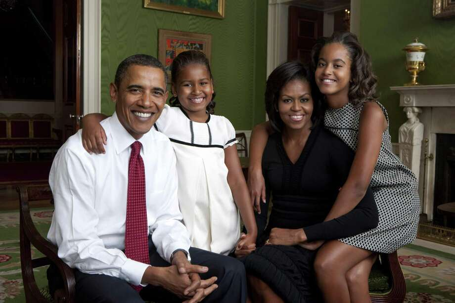 President Barack Obama, Malia, Michelle and Sasha sit for portrait in the Green Room of the White House Sept, 1, 2009, in Washington, D.C. Photo: Handout, Getty Images / 2009 White House