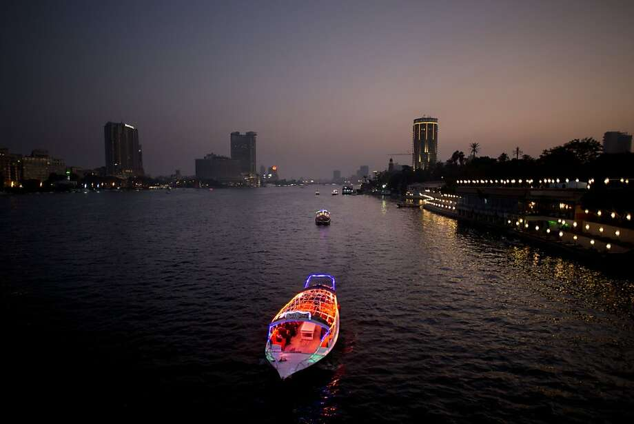Night cruise: A brightly lit boat navigates the Nile River in Cairo. Photo: Bernat Armangue, Associated Press