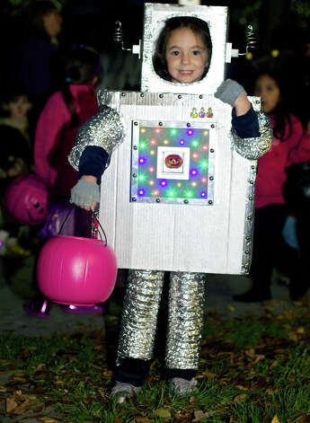 Kyra Chandler, 5, of New Milford proves to be a charming little robot during New Milford Parks & Recreation's Halloween celebration called Trunk or Treat on the Village Green. Oct. 31, 2012 Photo: Trish Haldin