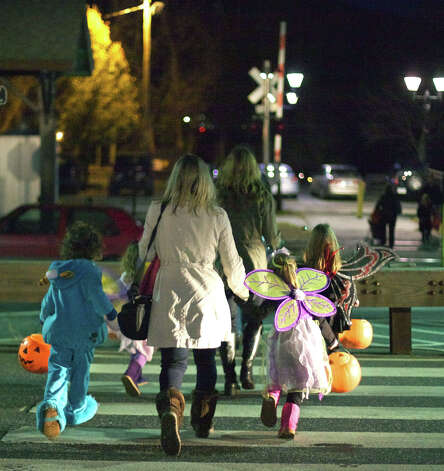 It's time to head home for this happy band of trunk or treaters following New Milford Parks & Recreation's Halloween celebration called Trunk or Treat on the Village Green. Oct. 31, 2012 Photo: Trish Haldin