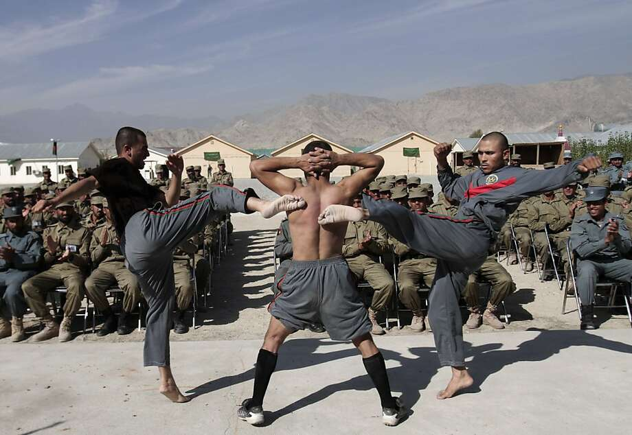 Kung fu cops: In Afghanistan's Laghman province, newly graduated police officers demonstrate the skills that will enable them to keep law and order after the Americans are gone. Photo: Rahmat Gul, Associated Press