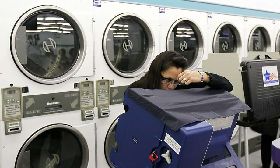 For once, a clean election count in Chicago: Leslie Fabian casts her ballot at the 24-hour Su Nueva Laundromat in the city's 13th Ward. Photo: Charles Rex Arbogast, Associated Press