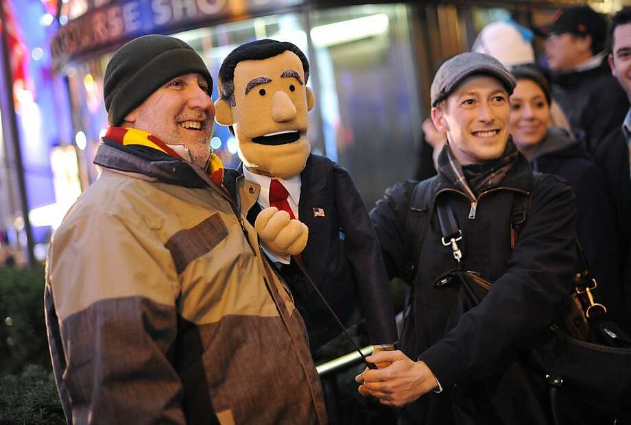 "Forgive him, Big Bird: Having lost the election, Mitt Romney resorts to Plan B - auditioning for ""Sesame Street."" (Election night, Rockefeller Center in New York.) Photo: Mike Coppola, Getty Images"