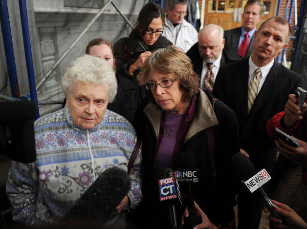 Lois Krakowski, left, grandmother of Ashlie Krakowski, and Susan Servin, mother of David Servin, respond to the verdict against former Milford police officer Jason Anderson outside Superior Court in Milford on Wednesday, November 7, 2012. Anderson was found guilty on counts of reckless driving and misconduct with a motor vehicle for the June 12, 2009 crash that took the lives of Orange teens Krakowski and Servin. Photo: Brian A. Pounds / Connecticut Post