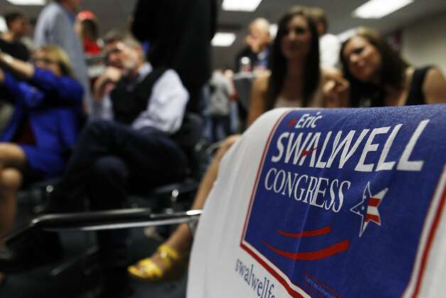 Supporters of Eric Swalwell watch results come in for President Obama before Swalwell arrives at an election night event to await results in his bid for congress on Tuesday, November 6, 2012, in Pleasanton, Calif. Photo: Carlos Avila Gonzalez, The Chronicle