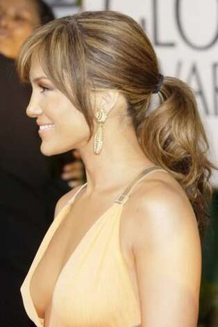 "Jennifer  Lopez, 2004   Equal  parts glamour-girl and girl-next-door, Jennifer Lopez is channeling her  inner ""Jenny from the block"" in this simple, wisp-heavy ponytail. Photo: SGranitz, WireImage"