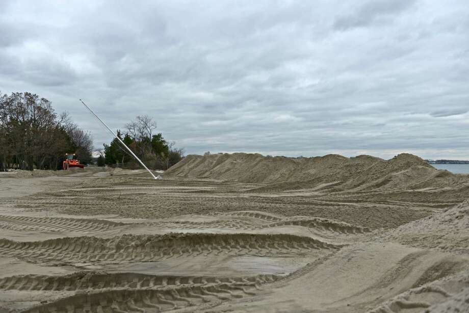 Hurricane Sandy transported 6,000 to 8,000 cubic yards of sand from the Greenwich Point beach across the adjoining parking lot and roadways. Photo: Contributed Photo / Greenwich Citizen