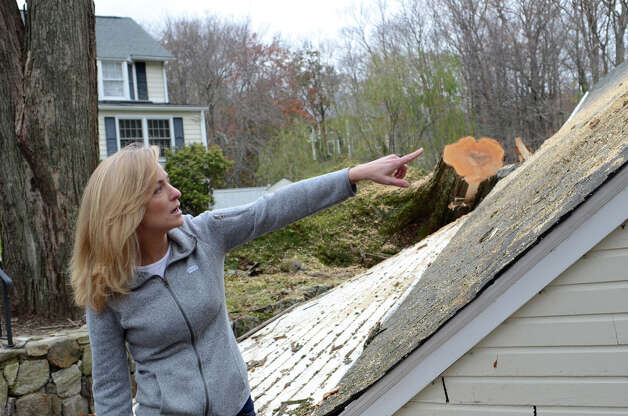 Michelle Morris surveys the damage to her garage and cars, located on Hunting Ridge Rd. in Stamford, on Thursday, Nov. 1, 2012. Photo: Amy Mortensen / Connecticut Post Freelance