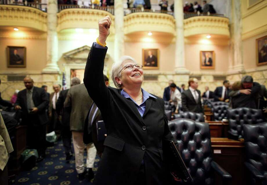 Allows gay marriage: Maryland. In this Feb. 17, 2012 file photo, Rep. Maggie McIntosh, D-Baltimore  City, gives a thumbs up to spectators in a balcony above the House floor  after members of the Maryland House of Delegates passed a gay marriage  bill in Annapolis, Md. Voters signed off on the bill on Tuesday.  Photo: Patrick Semansky, Associated Press / AP