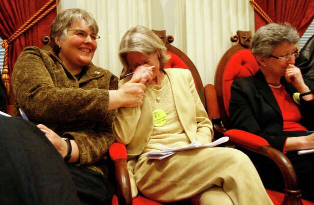 Allows gay marriage: VermontGay marriage advocate Beth Robinson, center, holds back tears following 